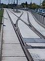 'Hódmezővásárhelyi Népkert vasútállomás' Straßenbahnhaltestelle, Weiche, 2021 Hódmezővásárhely.jpg