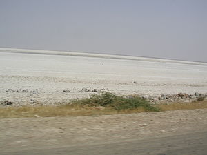 Sabkhat al-Jabbul - Shallow parts of the lake go dry in August leaving salt crystals on the floor