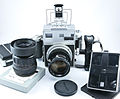 0527 Mamiya Universal Silver 100mm f2.8 127mm f2.4 6x9 and Polaroid back (9124104786).jpg