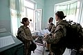 100803-M-0301S-030 HM2 Claire E. Ballante, right, assigned to the Female Engagement Team (FET), tours a free health clinic while patrolling.jpg