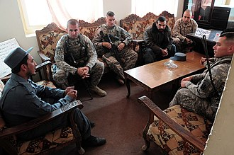 101st Field Artillery Regiment - 86th Infantry Brigade Combat Team (IBCT) visit the town and police department of Shakadara, Afghanistan. Members of the 86th IBCT regularly provide mentoring and training to police departments in outlying areas of Kabul