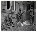 111-SC-197564-S - Three Americans of the 117th Infantry Regiment are about to enter a house where several enemy snipers are holding out. The town where this action took place, is Stavelot, Belgium.jpg