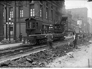 Toronto Railway Company - Maintenance car, with crane, replacing track on Queen and Bond Streets (April 29, 1917)