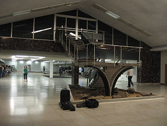 Birmingham–Shuttlesworth International Airport - The lobby of the 1962 Birmingham Air Terminal viewed from the front doors. The ticketing area is in the background and the stair led to the boarding area.  The terminal was torn down to make way for the 2011 terminal expansion.