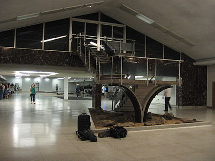 The lobby of the 1962 Birmingham Air Terminal viewed from the front doors. The ticketing area is in the background and the stair led to the boarding area. The terminal was torn down to make way for the 2011 terminal expansion. 1962 Birmingham Air Terminal IMG 3089.JPG