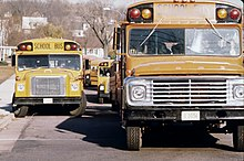Two conventional school buses, from left to right: a Ward Volunteer with International Harvester chassis, and a Wayne conventional with Ford chassis, photographed in the mid-1970s.