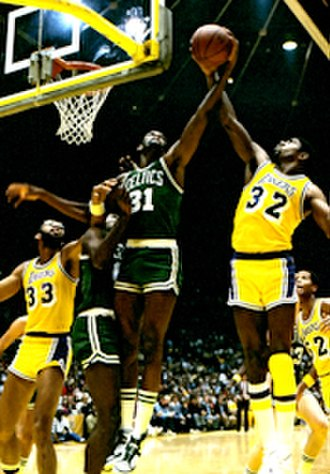 Magic Johnson - Johnson (right) battles Boston's Cedric Maxwell in 1985 NBA Finals