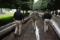 2015 Law Enforcement Explorers Conference carrying wreath down the path.jpg