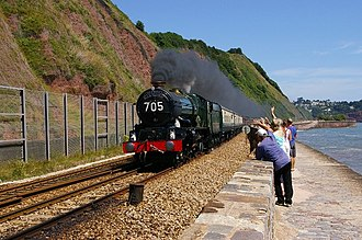 Torbay Express - Ex-GWR 'King' 4-6-0 No.6024 King Edward I heads the revived Torbay Express charter at Sprey Point, Devon, July 2006