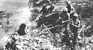 M116 howitzer - 75 mm pack howitzer on carriage M8 during the Battle of Tinian.