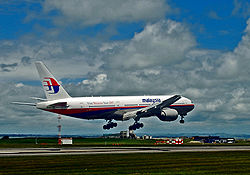 A Malaysia Airlines Boeing 777 landing on the main runway.
