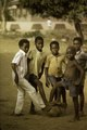 ASC Leiden - F. van der Kraaij Collection - 01 - 021 - Five boys in the street posing with a football, most of them barefooted - Monrovia, Old Road, Montserrado County, Liberia, 1976.tiff