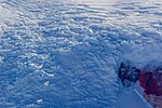 A Close-up of a Glacier Flowing Through a Section of the McMurdo Dry Valleys in Antarctica (30877662556).jpg