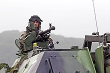 A Czech soldier waits for a convoy during Saber Junction 2014 at the Hohenfels Training Area in Hohenfels, Germany, Sept 140902-A-ZG808-062.jpg