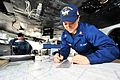 A Sailor navigates USS Ronald Reagan. (11309342275).jpg