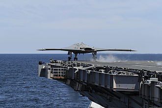 Naval aviation - The experimental X-47B performs the first successful catapult launch of an unmanned aerial vehicle (UAV) from an aircraft carrier in 2013.