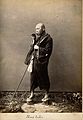 A blind Japanese masseur with a pipe in his mouth and a long Wellcome V0029652.jpg