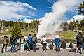 A crowd gathers to watch an eruption of Riverside Geyser (35941822914).jpg