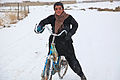 A local Afghan boy stops his bicycle to observe U.S. Soldiers stationed at Combat Outpost Zormat patrol, near his village in Paktya province, Afghanistan, Jan. 30, 2012 120130-A-LP603-098.jpg