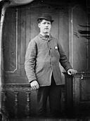A man wearing a hat standing NLW3364813.jpg
