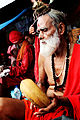 A saint sitting at Ambubasi Mela.JPG