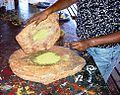 Aboriginal grain grinding. Uluru, (Ayers Rock), Australia.jpg