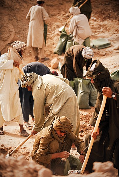 File:Afghan day laborers help Marines fill sandbags (5224388587).jpg