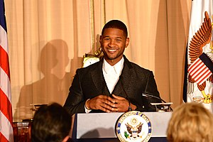 American Artist Usher Delivers Remarks at the 2015 Kennedy Center Honors Dinner in Washington (23586745516).jpg