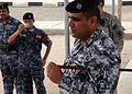 An Iraqi police academy commander, right, observes students practicing clearing a building at the police academy in Basra, Iraq, April 20, 2011 110420-A-YD132-167.jpg