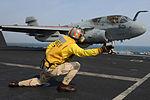 An officer launches an EA-6B..jpg