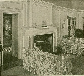 Millwork (building material) - Traditional interior millwork examples. Note the wall covers, as well as the door and window trim, are all custom-styled to compliment the central focus point of the room – the fireplace mantle.