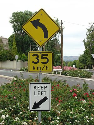 Speed limits in Australia - 35 km/h speed advisory sign above a keep left sign