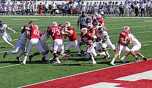Blocking (American football) - Linemen blocking for the running back.