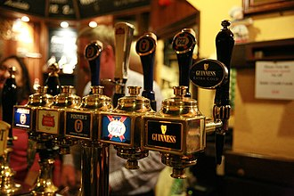 Beer tap - An array of draught beers served by taps.