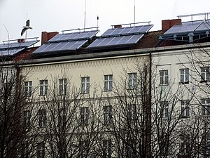 Photovoltaic cells in use on top of a building in Berlin.