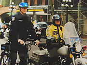 Vancouver police constables from the bicycle and motorcycle squads, on the streets of Gastown.
