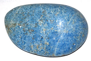 Buryatia - Unusual blue diopsidite skarn from the Dovyren Highlands, Buryatia. This tumble-polished rock is around 700my old.