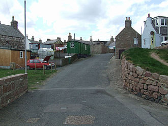 Boddam, Aberdeenshire - Former fishing cottages and outbuildings with converted railway wagon
