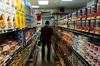 Food desert - A typical urban corner shop. All the food visible is relatively imperishable: dried, processed and tinned products, which may have a low vitamin and nutritional content compared to fresher produce. Shown below is a vegetable counter of a larger supermarket.