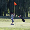 Boy pulls on flag - East Potomac Golf Course - 2013-08-25.jpg