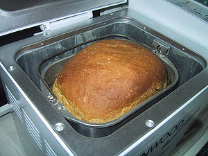 Breadmachine with freshly baked bread.