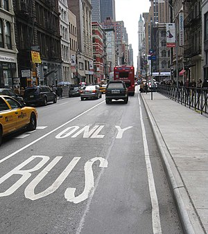 "Bus lanes in New York City - Bus lane on Broadway in Manhattan, painted with the words ""BUS ONLY"""