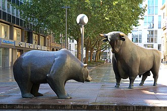 Market trend - Statues of the two symbolic beasts of finance, the bear and the bull, in front of the Frankfurt Stock Exchange.