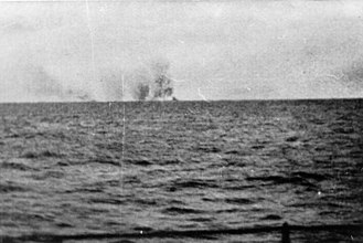 Battle of the Denmark Strait - A photo probably taken from the Prinz Eugen shows the Hood exploding in the far distance with the Prince of Wales nearby