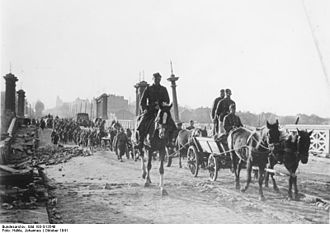 First Battle of Kharkov - German troops enter Kharkov from the west, crossing the main railroad running through the city on the viaduct of Sverdlov Street.