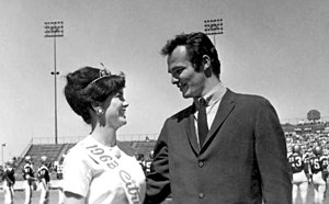 Burt Reynolds - Reynolds with the Citrus Queen at Garnet and Gold Football Game, Florida State University, 1963