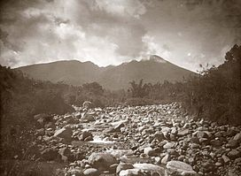 View of Mount Salak from a rocky river bed (ca.1920).