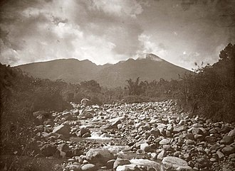 Mount Halimun Salak National Park - View of Mount Salak from a rocky river bed (c. 1920).