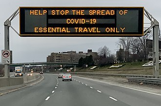 A highway sign on the Gardiner Expressway in Toronto discouraging non-essential travel COVID-19 highway sign in Toronto, March 2020 (cropped).jpg
