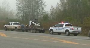 British Columbia Commercial Vehicle Safety and Enforcement - CVSE Patrol car with lights activated at a traffic stop.